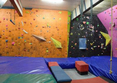 Orange vertical wall and black slab